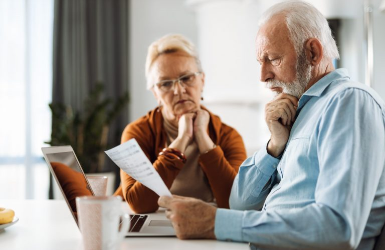 Mature,Couple,Working,On,Their,Home,Finances,At,Home